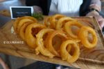 Crispy battered onion rings w. truffle aioli